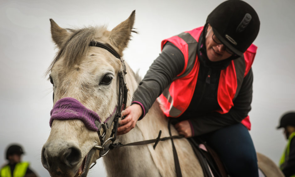 Jenny Ash, 28, with horse Silvy.