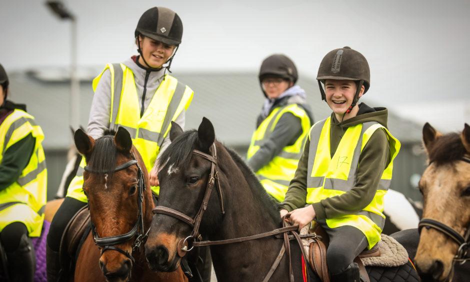 Oliver Robbie, 13, on his horse Ferrari.