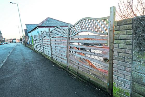 A damaged fence on Kinghorne Road.