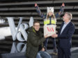 Philip Long Director of V&A Dundee presents Jan Becker and his daughter Nalani, 7, from Berlin with the goody bag.