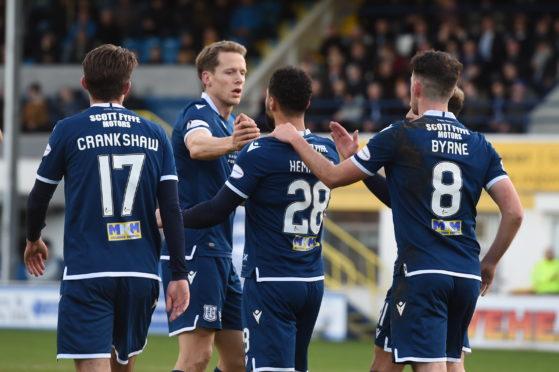 Dundee's Kane Hemmings celebrates his goal with Christophe Berra.