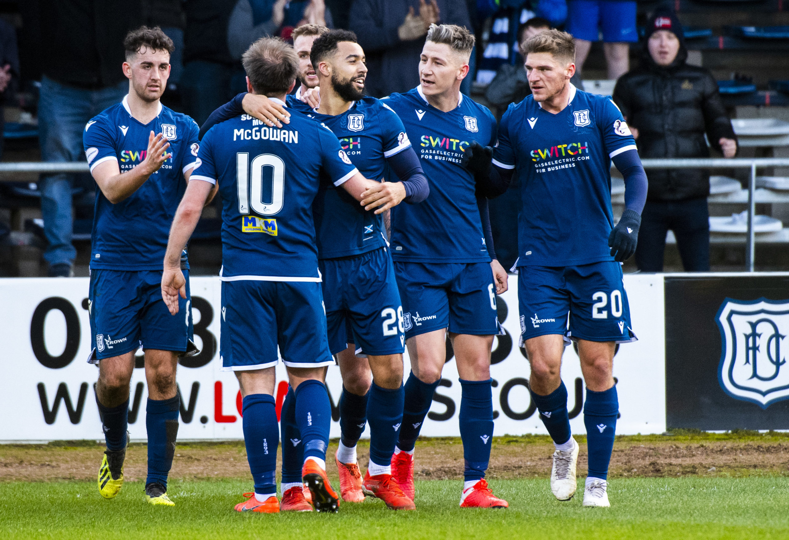 Hemmings celebrates with teammates on Saturday. The striker netted a brace against Partick Thistle.
