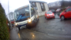 In one piece of footage, Alan is forced to step back to give the bus room to make the turn.