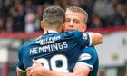 Kane Hemmings hugs Andrew Nelson earlier this season.