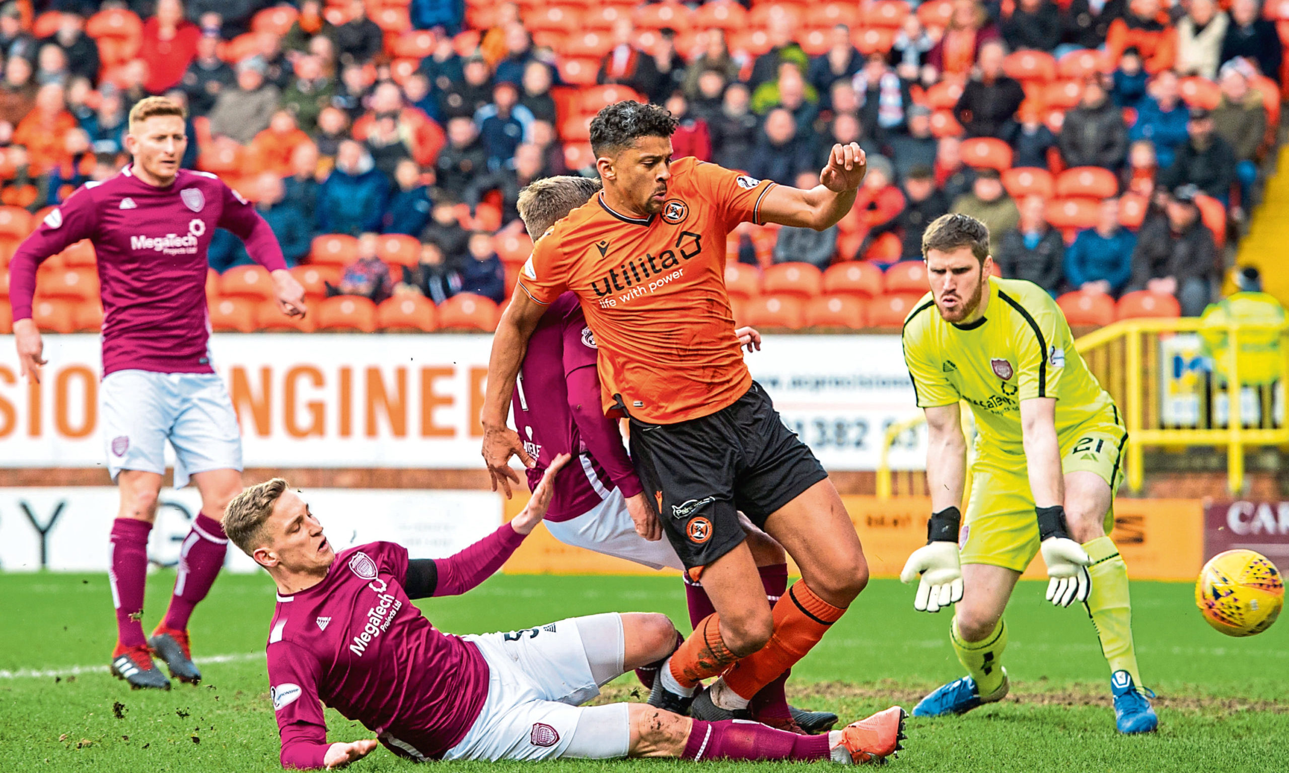 Dundee United's Osman Sow is tackled by Arbroath's Thomas O'Brien.