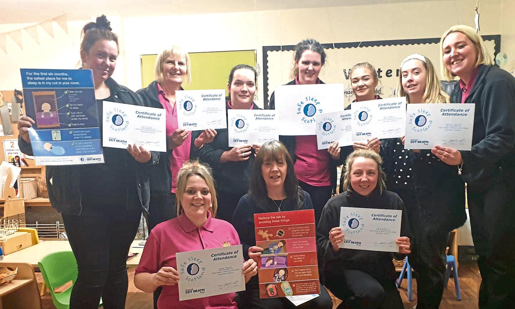 Ninewells Nursery staff with their  Sleep Safe Scotland qualifications.