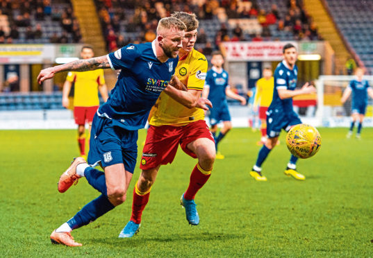 Dundee's Christie Elliot and James Penrice in action.