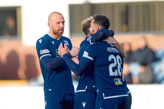 Jordon Forster and Declan McDaid congratulate Kane Hemmings of Dundee after the striker had scored the opener.