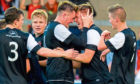 Jordan Moore celebrates with then-Dundee United team-mates John Souttar, Andy Robertson (left) and Blair Spittal (right) after scoring against Forfar in a 2014 pre-season friendly.