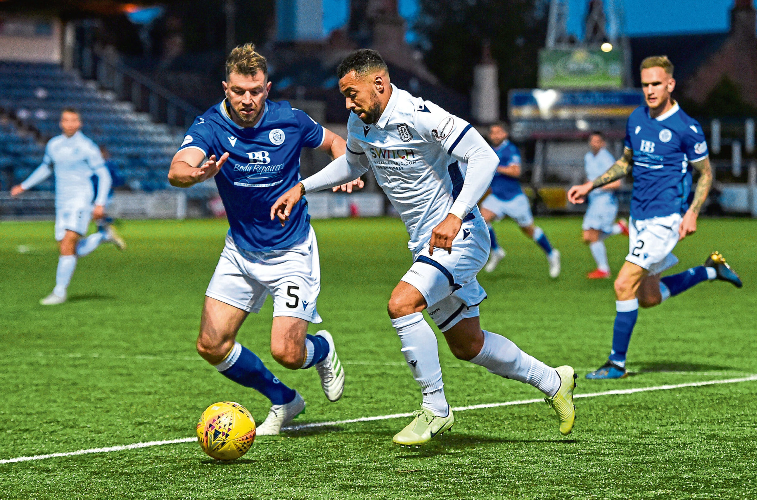 Queen of the South's Darren Brownlie, left. in action with Dundee's Kane Hemmings when the sides met in September.
