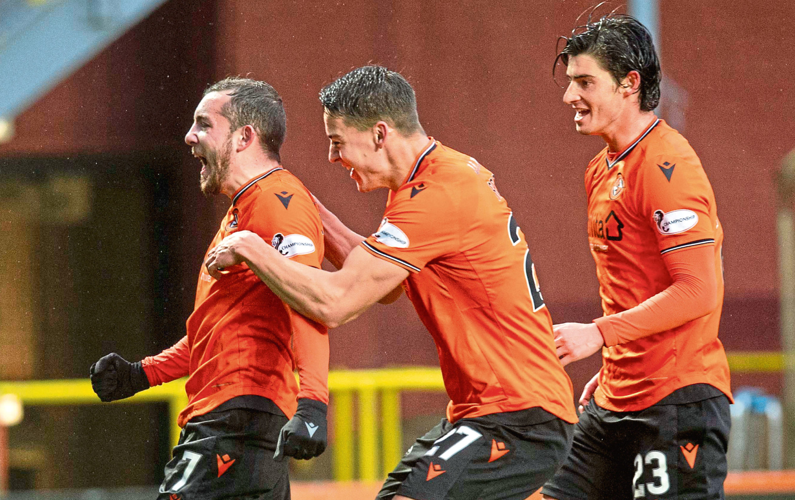 Paul McMullan celebrates with Louis Appere (centre) and Ian Harkes against Queen of the South earlier this season.