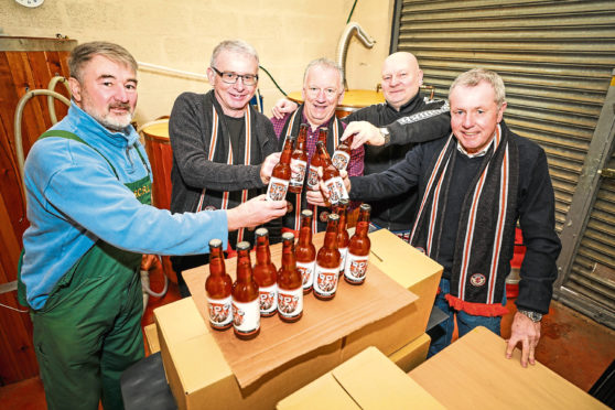 David Guy, Martin Manzi, Ged Bell, Danny Cullen and Michael Evans with the new 1909 Lager for the Jim McLean production.