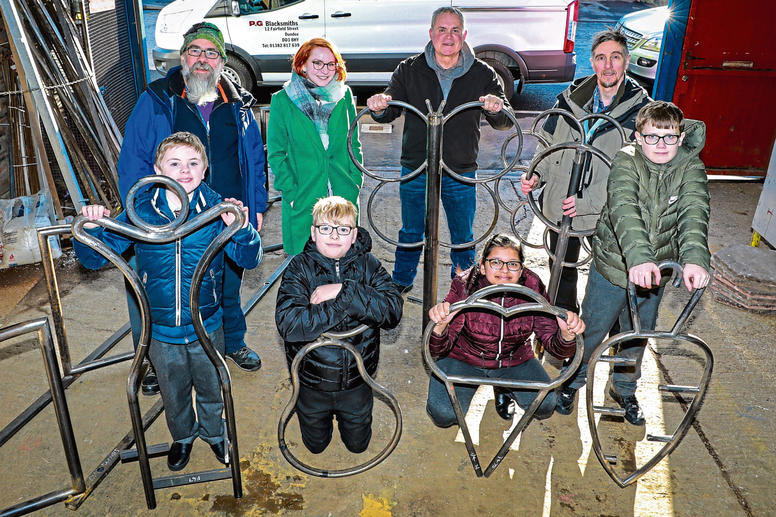 Picture shows (back) David, designer Kirsten MacGregor-Manzi, Gary Carling of P&G Blacksmiths and John Whyman of Dundee City Council. Front: Drew Marr and Alfie Park (both 11), Amina Nassir, 12, and Finlay Smith, 11, from P7B at Blackness Primary who designed the cycle racks.