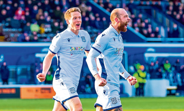 Dundee's Jordan Forster celebrates after scoring to make it 1-0 for Dundee.