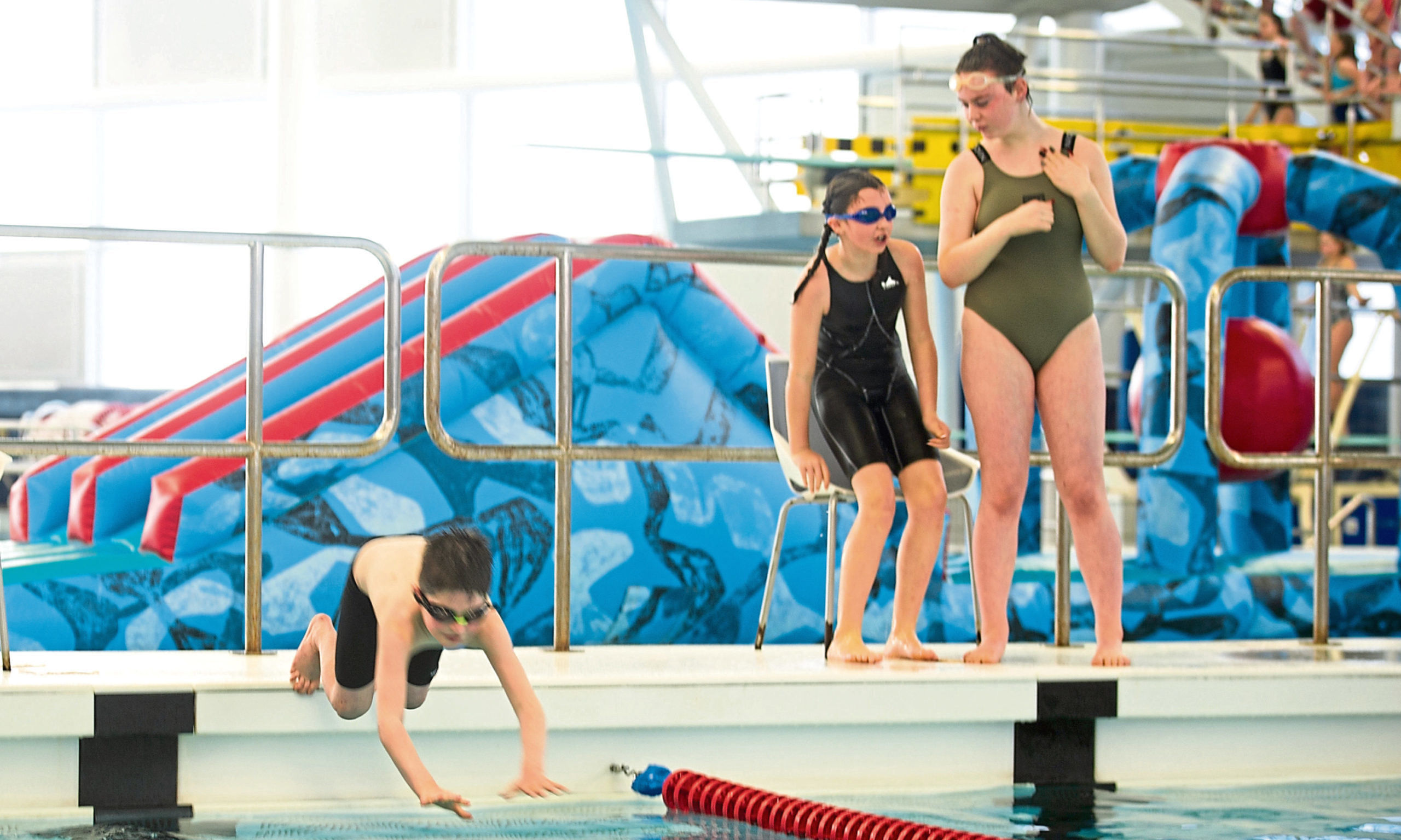 Swimmers taking part in the relay event.