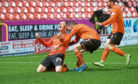 Lawrence Shankland of Dundee United is congratulated after netting the winner against Inverness Caledonian Thistle.