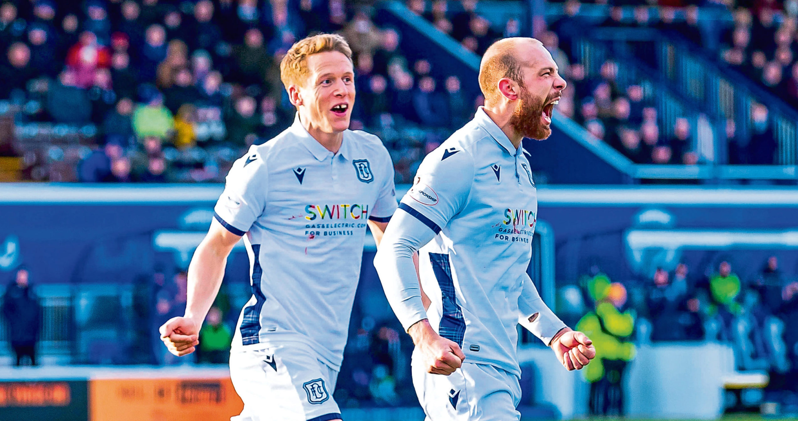 Jordan Forster celebrates after scoring to make it 1-0 to Dundee against Queen of the South.