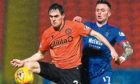Dundee United's Liam Smith and Inverness Caley's Miles Storey in action at Tannadice on Friday.
