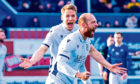 Christophe Berra rushes to congratulate Jordan Forster after his goal against Queen of the South.