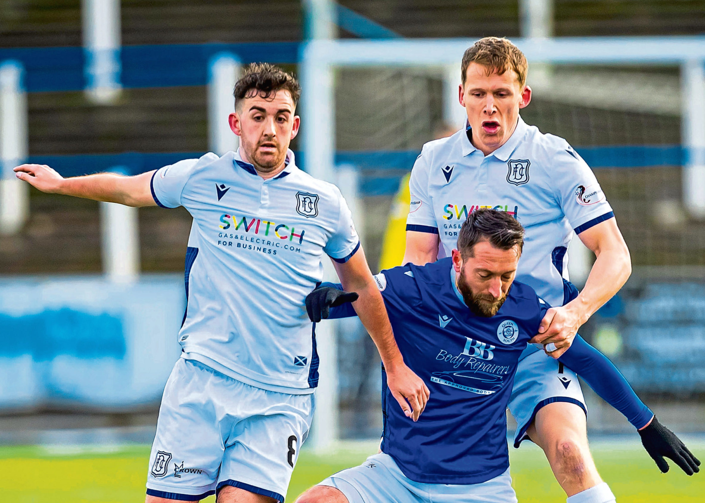 Shaun Byrne and Christophe Berra chase down Queens' Steven Dobbie on Saturday.
