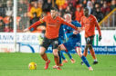 Calum Butcher holds off James Vincent of Inverness Caledonian Thistle during last Friday's victory at Tannadice.