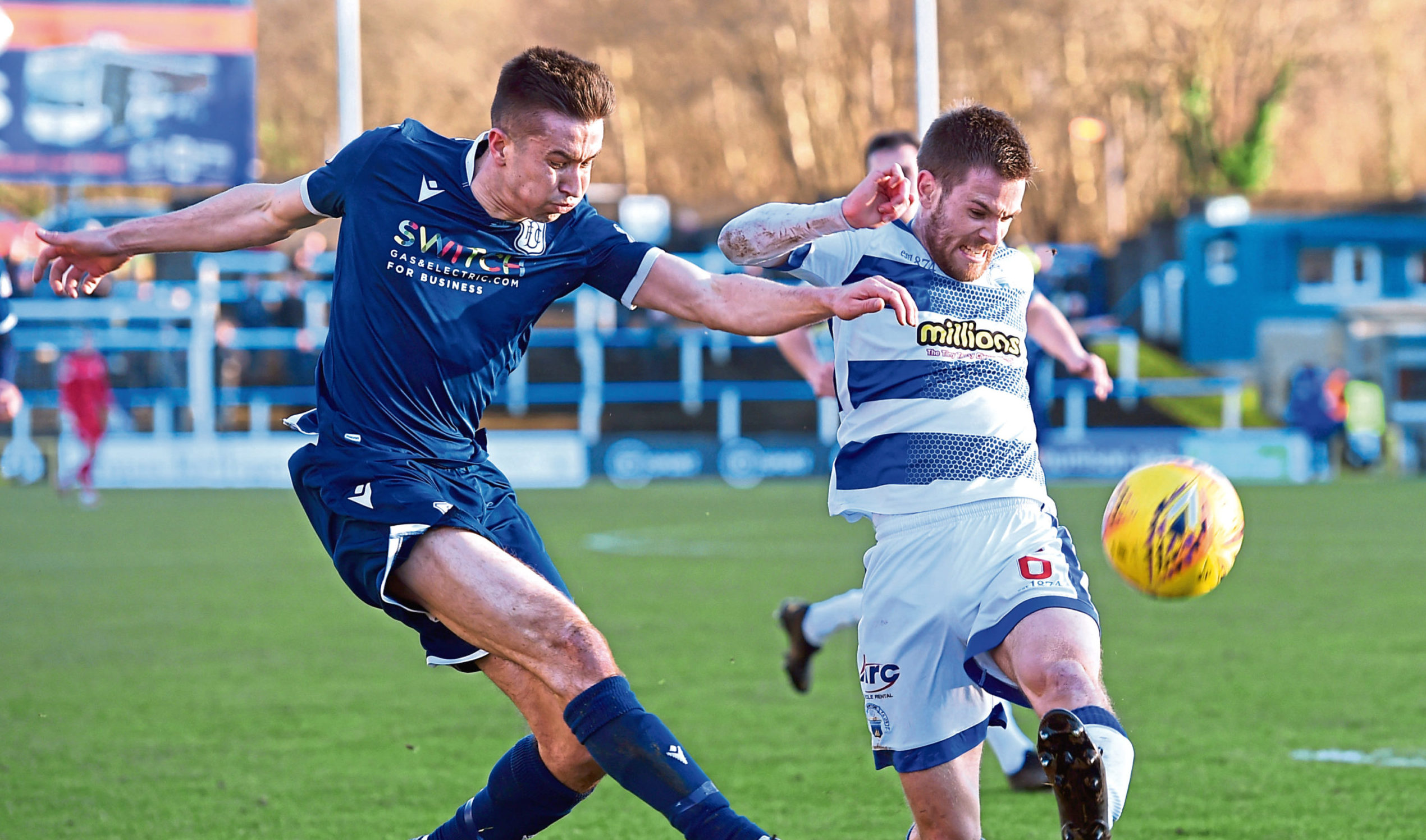 Cammy Kerr and Morton's Kyle Jacobs battle for the ball.