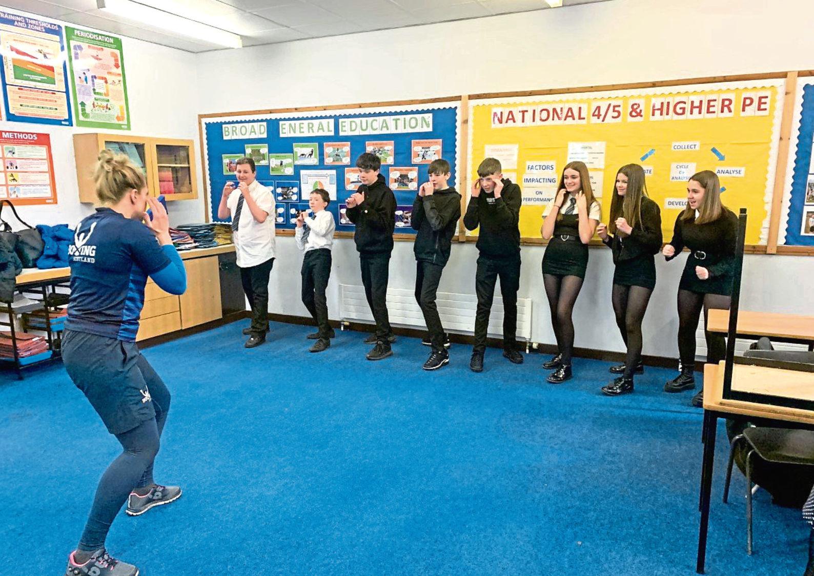 Morgan Academy Pupils with boxer Lynn Calder.