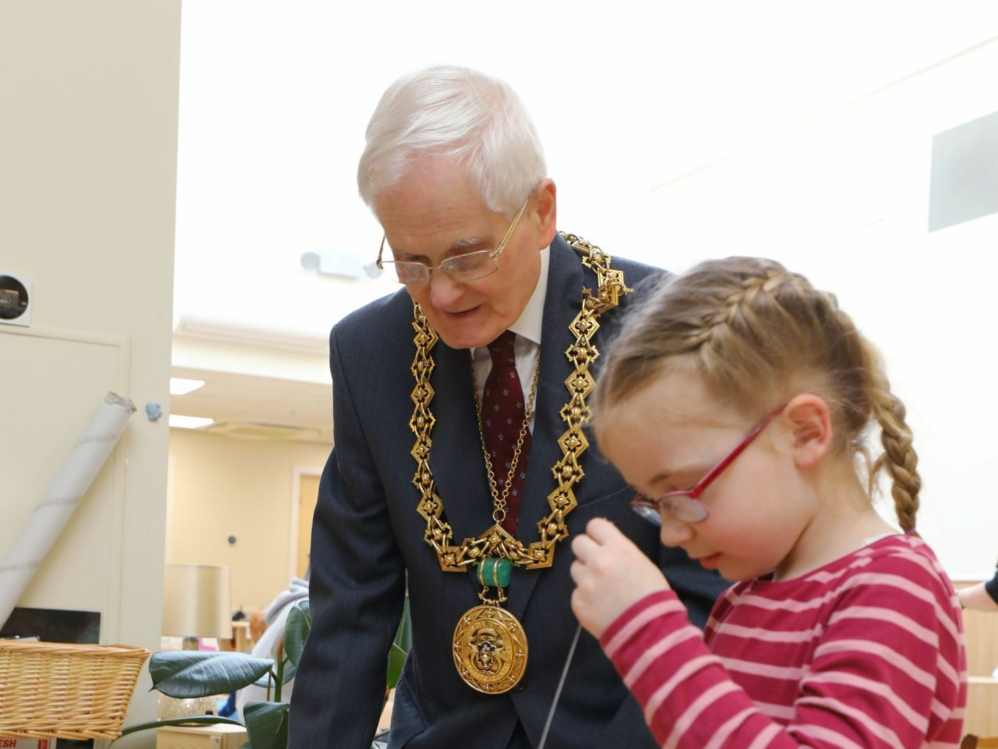 Lord Provost Ian Borthwick chats to some of the kids at the opening of the newly-refurbished Caird View Nursery, in Dundee on Friday.