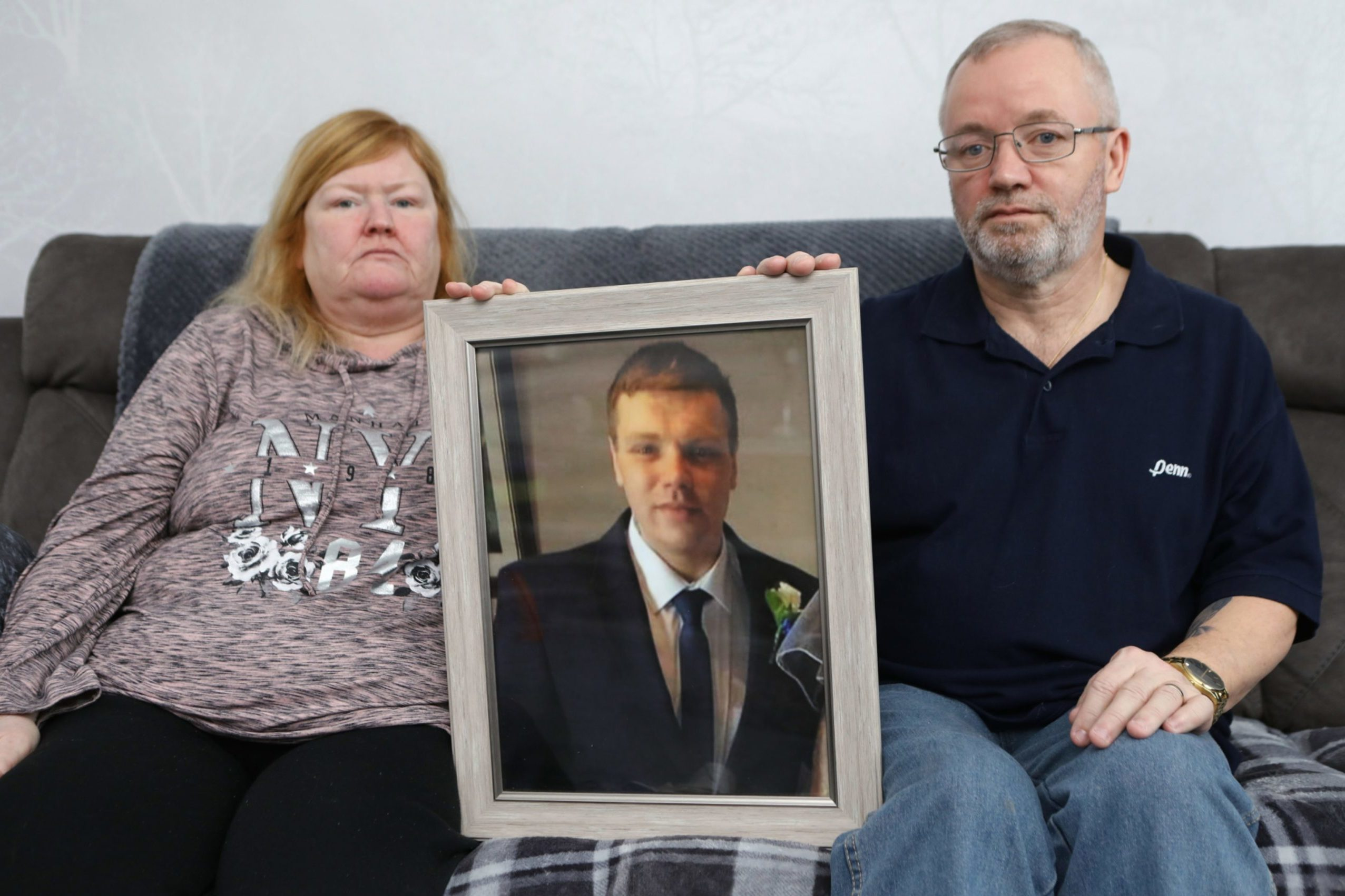 Linda and Garry Donnan at home with a picture of their late son, Garry jnr.