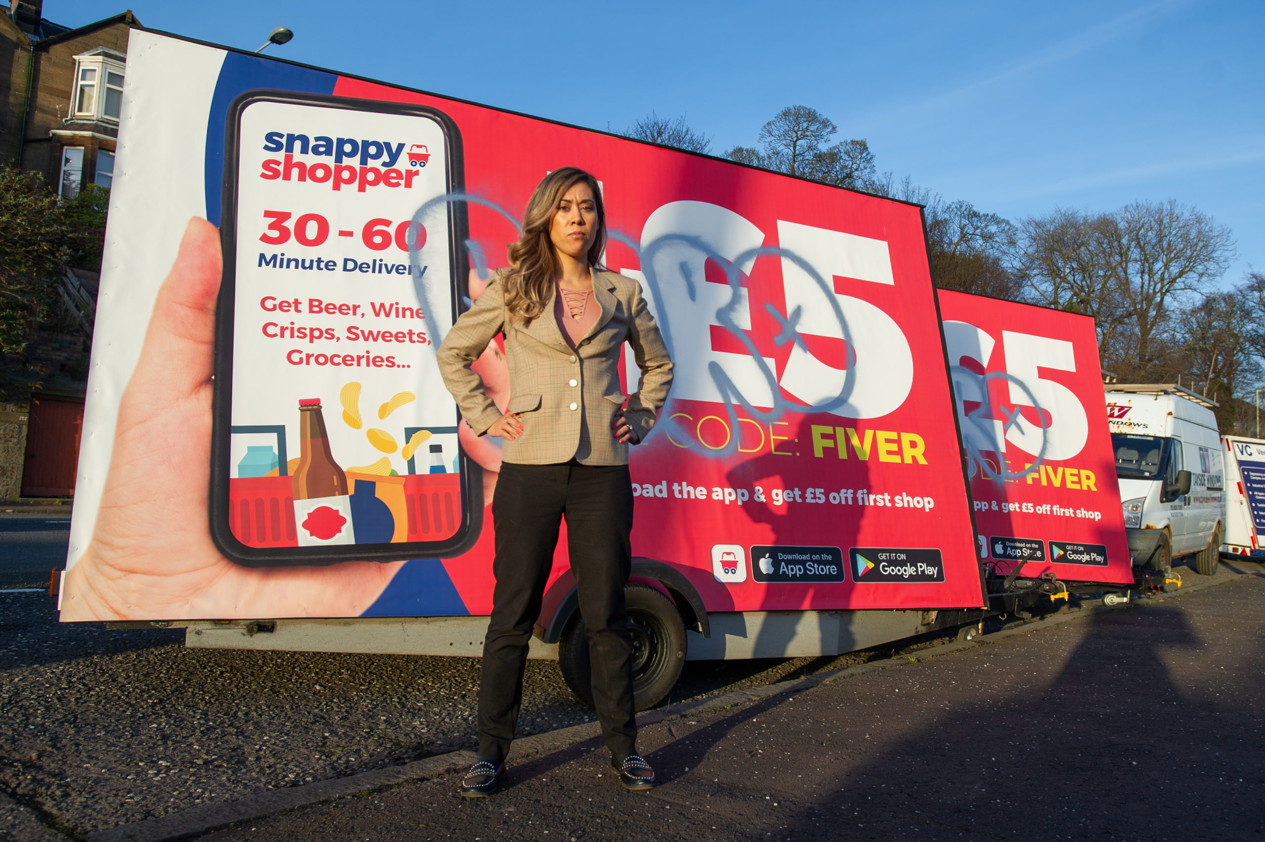 Ashley Blake, Head of Marketing, at Snappy Shopper, with the vandalised signs.