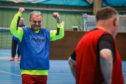 Reporter Kenny MacDonald celebrates one of his side's goals as he takes part in walking football for the first time.
