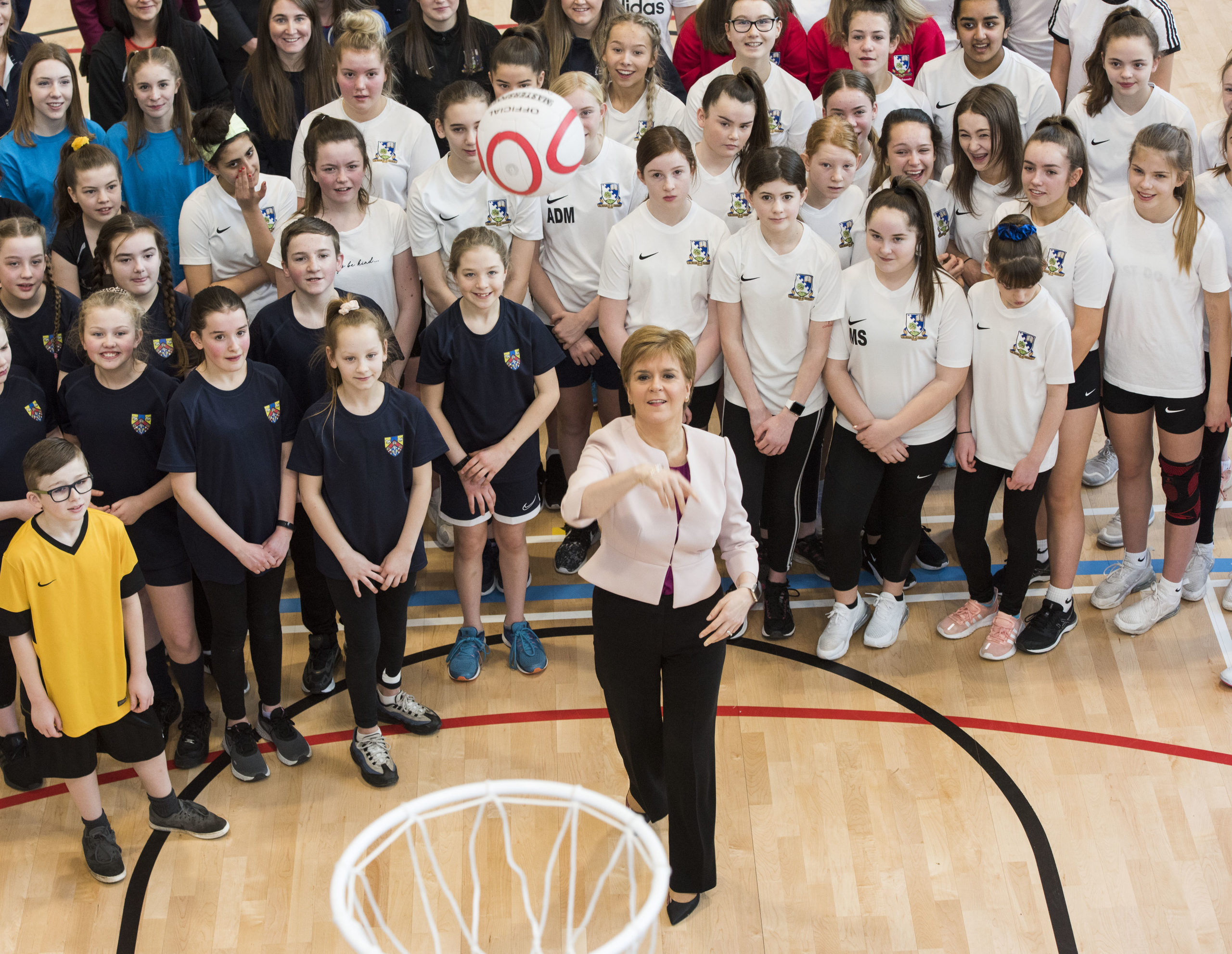 Pic For Alan Richardson Pix-AR.co.uk First Minister Nicola Sturgeon officially opened Dundee's £32 million Regional Performance Centre today as school children and athletes show how its top class facilities will help develop sporting skills for the future. The Caird Park campus has been up and running since the end of last year. It hosts a full size indoor 3G football pitch and outdoor 3G 'rugby sized' pitch suitable for both rugby and football. The pitches are designed to meet World Rugby and FIFA compliance standards and already Glasgow Warriors have had a training camp and both Dundee FC and Dundee United FC have trained at the centre. It also includes eight court multi sports hub building with spectator seating, a strength and conditioning suite and a state-of-the- art-sport science suite. An indoor athletics centre with an 80m running straight provides all-weather training for athletes, while the outdoor athletics track was resurfaced and a covered spectator area added. The velodrome has also been refreshed with a new area of hardstanding provided for competition, with upgraded floodlighting.