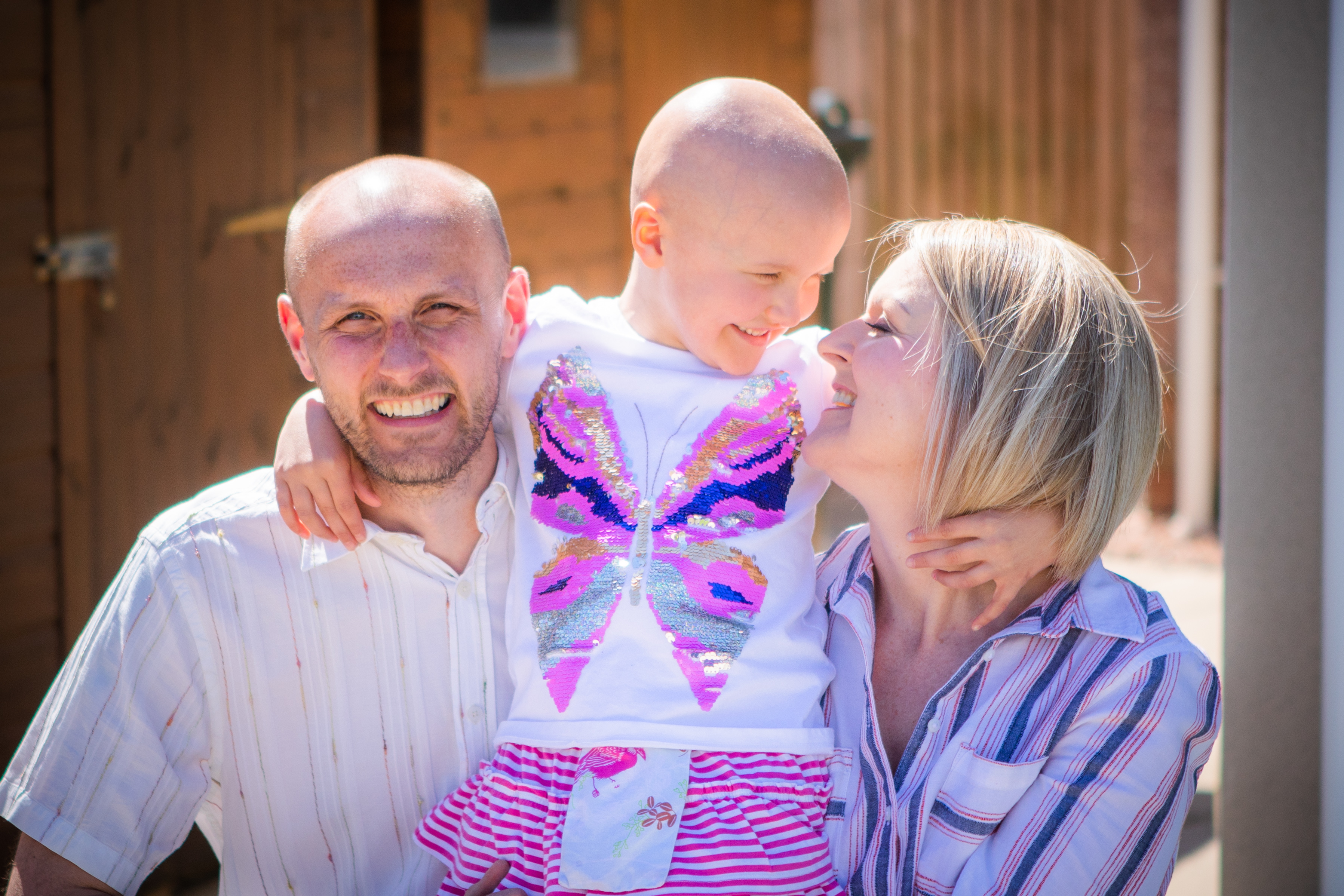 Ruby with her mum and dad, Claire and Andy.