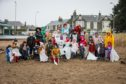 Childminders from across Dundee form together to cleanup Broughty Ferry beach.