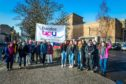Dundee University staff are striking in a dispute over pay, pensions and conditions.