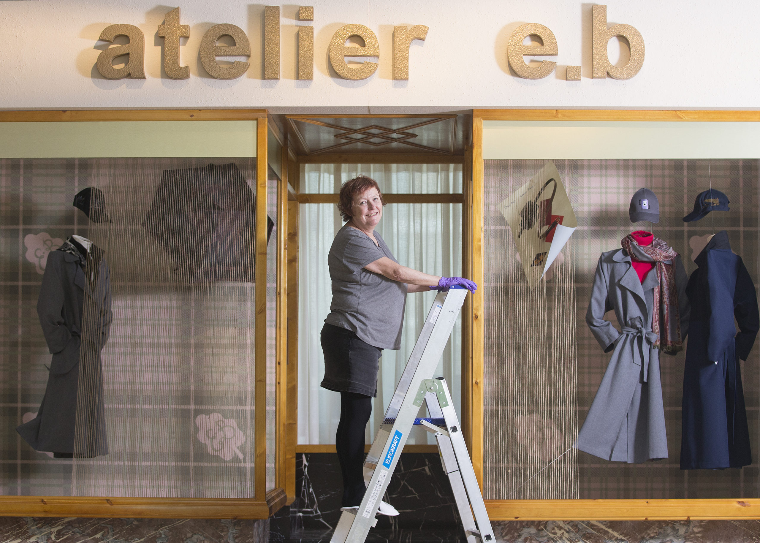 Window dresser Barbara Kelly puts the final touches to the shop window at the V&A. Photo: By Michael McGurk.