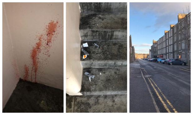 Blood was seen on a wall and drugs paraphernalia found on the steps in the close in Dundonald Street.