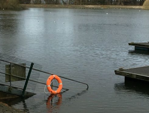 The lifebelts have become submerged due to rising water levels brought on by the severe weather.