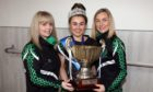 Niamh, centre, holding her trophy, flanked by her delighted coaches.