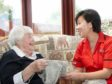 A Mears Care employee with a resident. (Stock image).