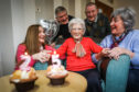May Christie who celebrates her 100th birthday, but will really be 25 as she is a leap year baby. May Christie with her children, clockwise from left, Rosilynn Wilson, Peter Christie, Angus Christie and Carole Urban.