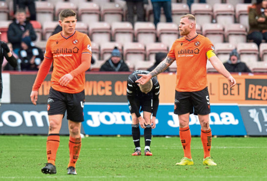 Mark Connolly (R) and Dillon Powers after going 2-0 down during a match between Dunfermline Athletic and Dundee United.