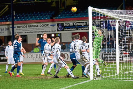 Christophe Berra sees his last-gasp effort saved by Alloa keeper Neil Parry at Dens.