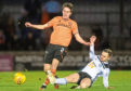 AYR, SCOTLAND - MARCH 03: Dundee United's Liam Smith is tackled by Alan Forrest during the Ladbrokes Championship match between Ayr United and Dundee United at Somerset Park on March 03, 2020, in Ayr, Scotland. (Photo by Gary Hutchison / SNS Group)