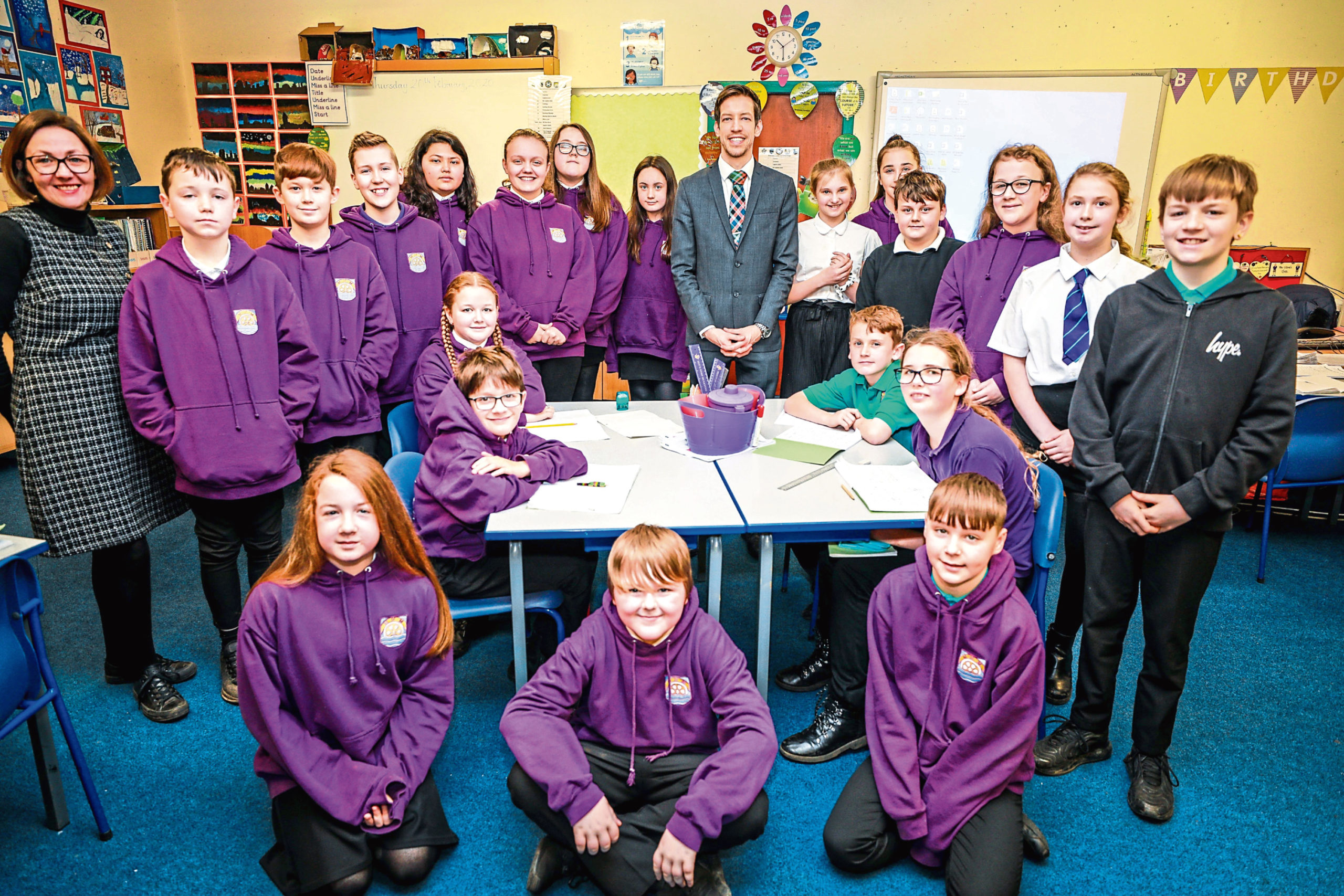 Primary 7 pupils with Councillor John Alexander.