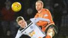 Ayr United's Luke McCowan holds off Mark Reynolds.