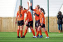 Tammy Harkin is congratulated after scoring a hat-trick in Dundee United's win over Queen's Park.
