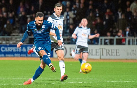 Kane Hemmings stays calm to slot in Dundee's opening goal against Ayr United at Dens Park.