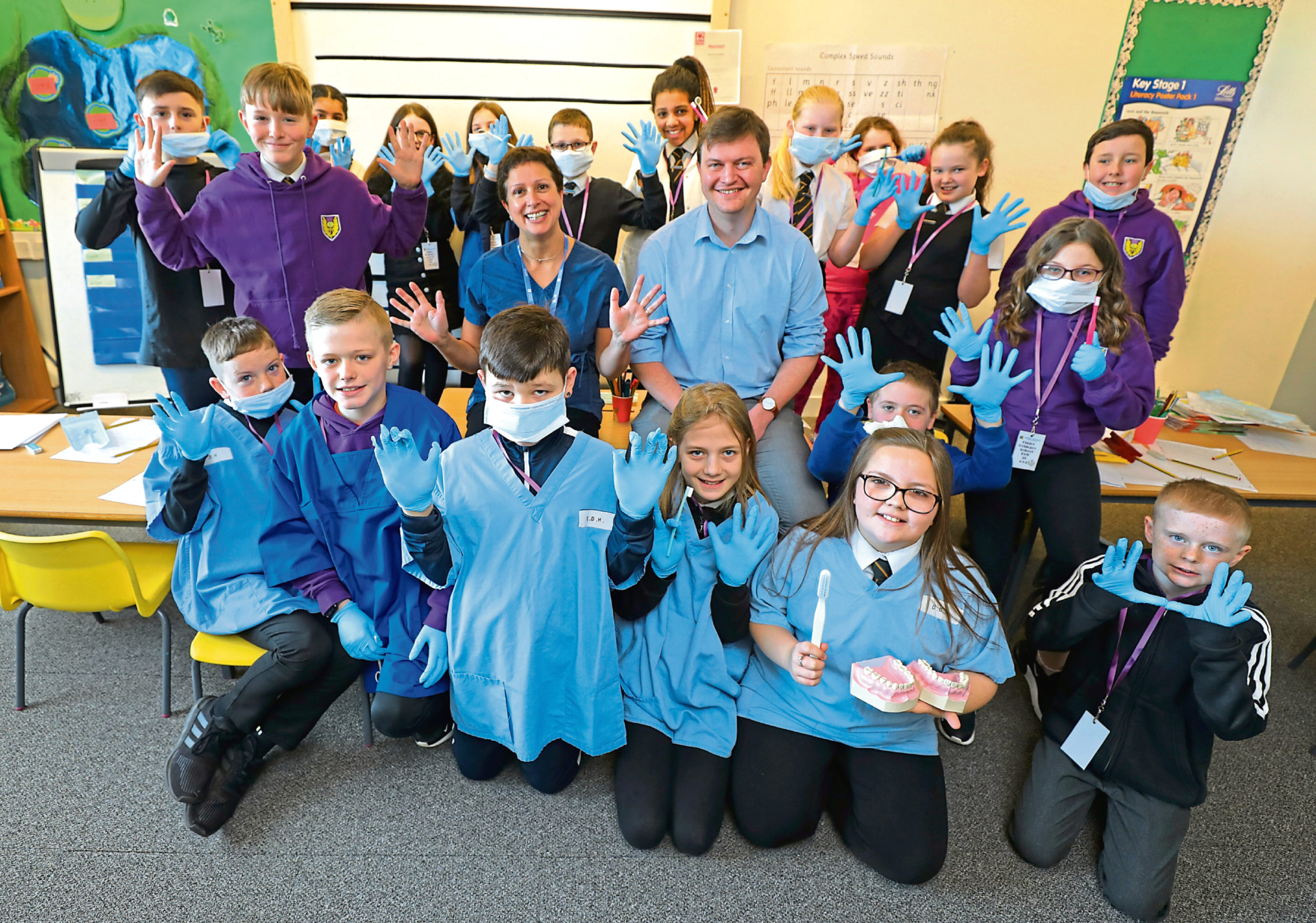 Professor Nicola Innes and Mark Robertson from Dundee Dental Hospital at Fintry Primary.
