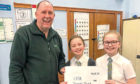 Primary 6 pupils from Ardler Primary raised over £900 for local foodbank as part of the Guildry Enterprise Project.
